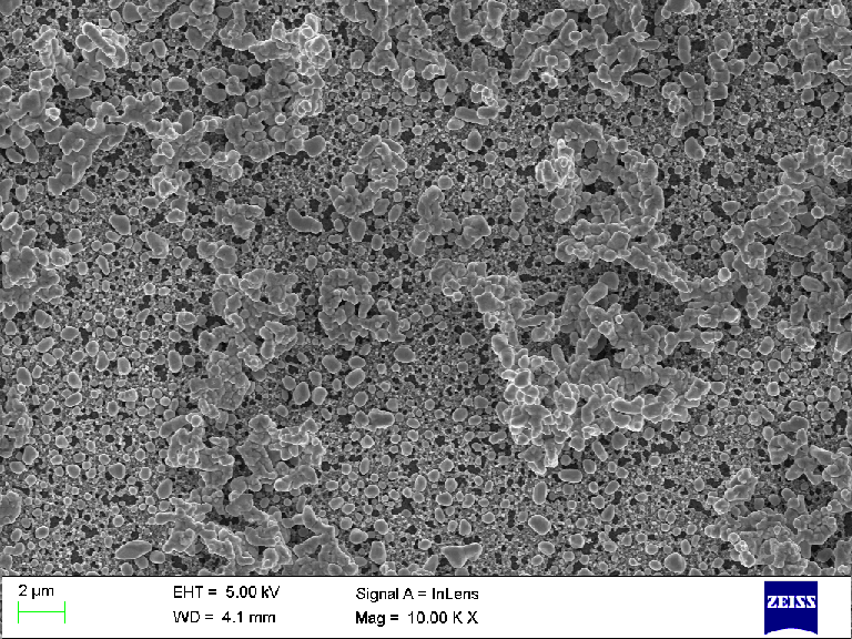 Scaled down png of SEM micrograph. Click on the image to download TIFF file in native resolution (sans tags). The sample is electrophoretically deposited TiO2 microparticles.